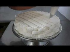 Cake decorating techniques - How to pipe Royal Icing piping demonstrations.... For more information about David MacCarfrae visit David Cakes website: http://...