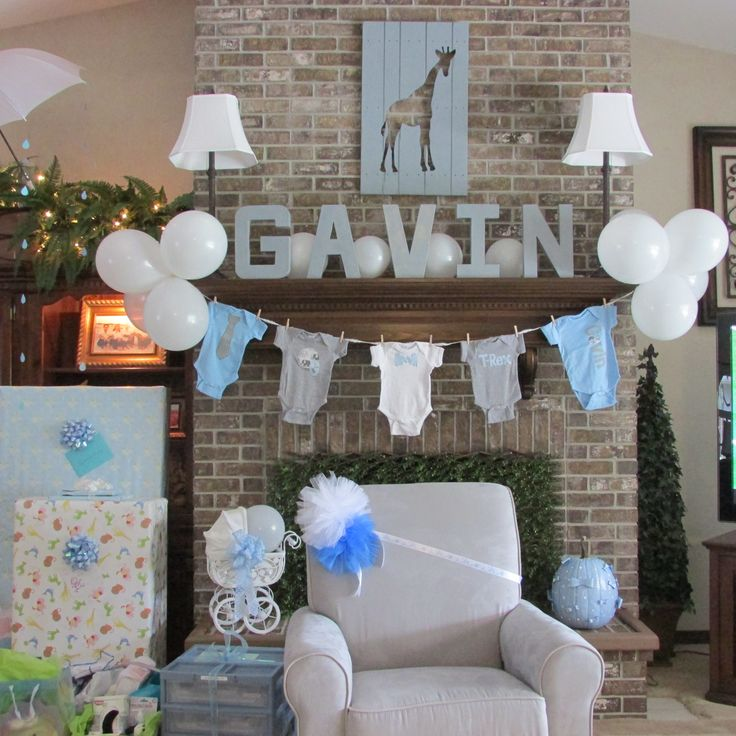 Onesie clothes line with white balloons and painted letter for Baby clothesline decoration