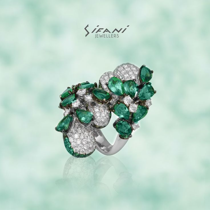Diamonds & Emeralds are a perfect combination in this intricately designed ring. #Ring #Diamond #Emerald #Design