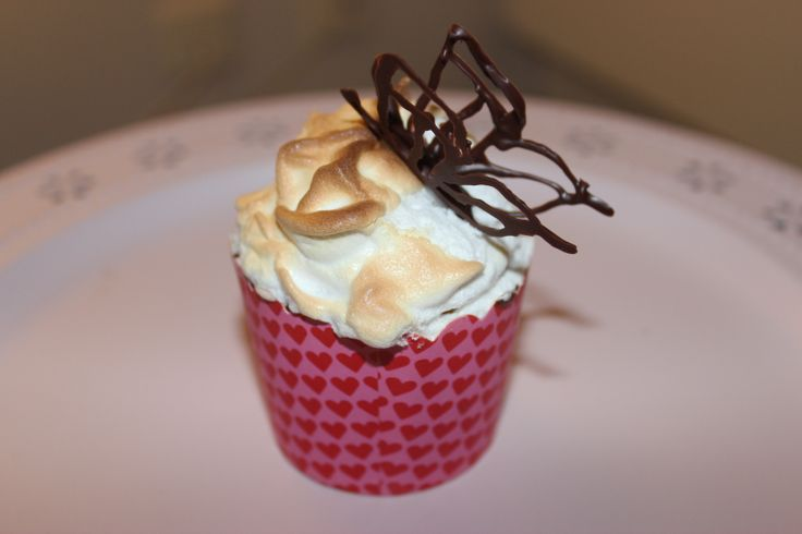 Lemon Meringue Cupcake filled with Lemon Curd and decorated with a chocolate butterfly