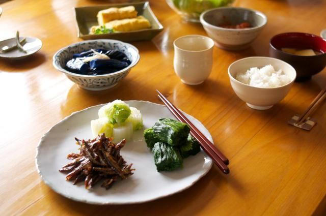 "Traditional Japanese Breakfast: ""A traditional Japanese-style breakfast consists of steamed rice, miso soup, and various side dishes. Common side dishes are broiled/grilled fish, tamagoyaki (rolled omelet), tsukemono pickles, nori (dried seaweed), natto (fermented soy beans), and so on."""