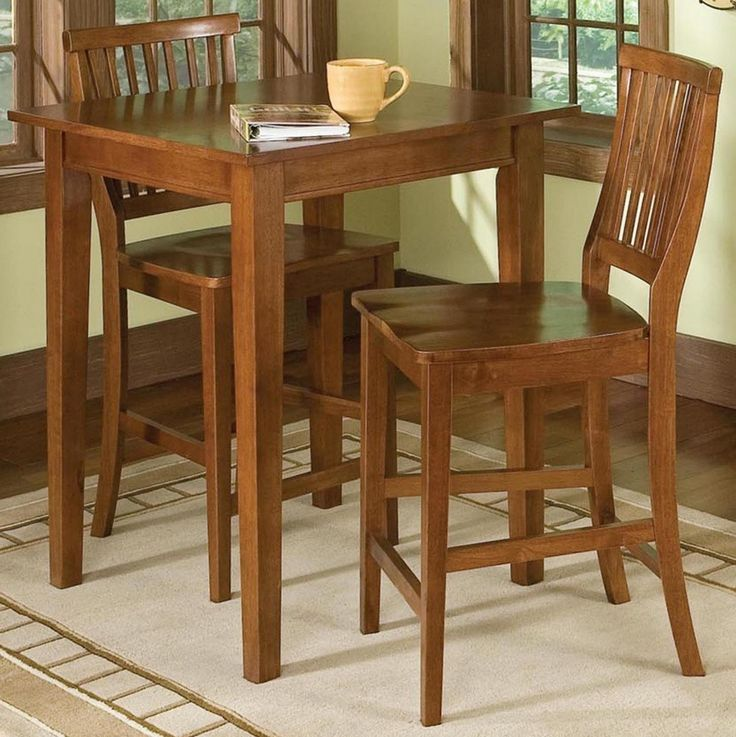The cottage oak pub table set is counter height warm and inviting for dining and entertaining. Includes tall square table two armless counter height chairs.
