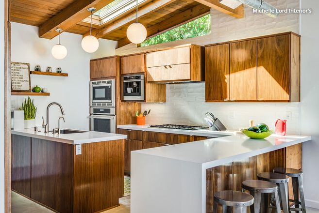 Special feature: Custom-made, high-gloss walnut slab-style cabinets with a bold…