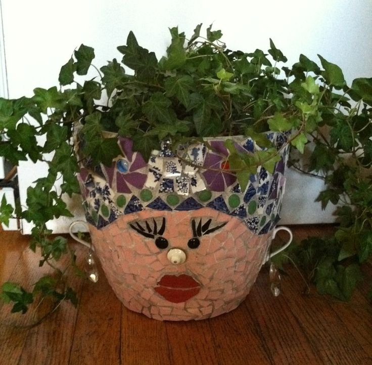 Carmen Miranda face mosaic flower pot. Made from recycled broken china and dishes
