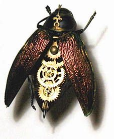 Mike Libby hybridizes insects and clockwork parts to create sculptures that look something like the vampiric mechanism from Guillermo del Toro's Cronos.