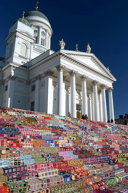 Over 8,000 crocheted afghans covered the steps of the Helsinki Cathedral in Finland. Often, Yarnbombing is done for charity or a cause. The Helsinki Cathedral yarnbombing installation was done in an attempt to break the Guinness World Record for the largest crocheted patchwork quilt in the world and then the quilts were donated.