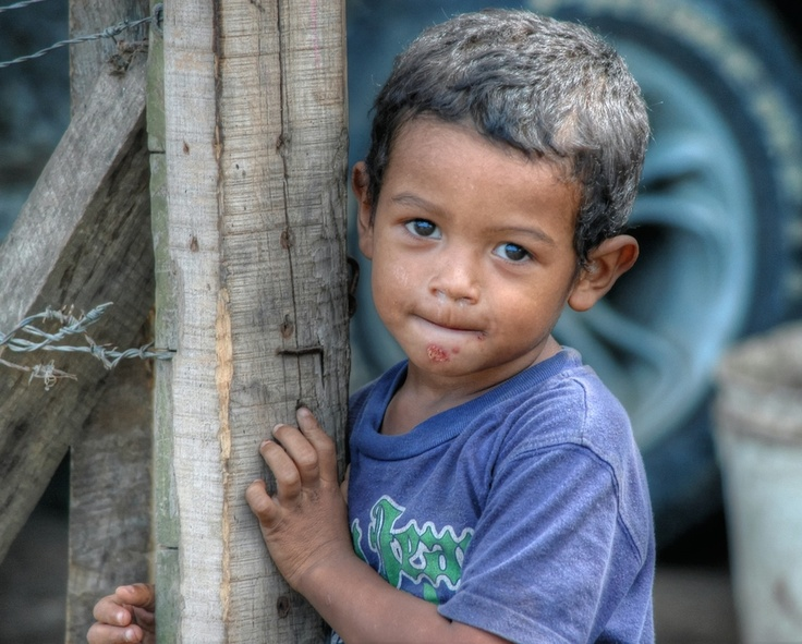 One of the many faces of Honduras. This little boy shyly poses in front of his home in the outskirts of the city of Trujillo