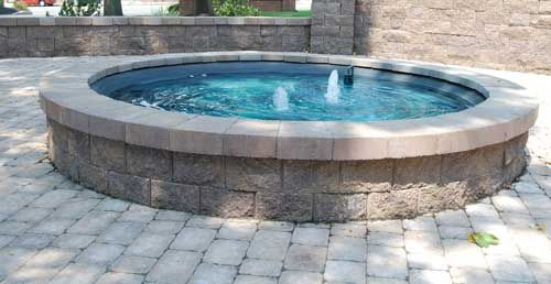Above ground pond using allan blocks home pinterest for Round koi pond