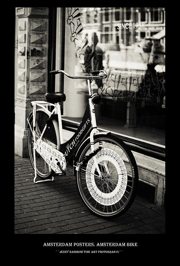 Amsterdam Posters. Amsterdam Bike by Jenny Rainbow.  Big collection of Amsterdam posters with black framing with concept of city architecture and street photos. This collection offering the same style for all the images and perfectly suits for wall decor of the bars and restaurants or minimalistic home interiors.