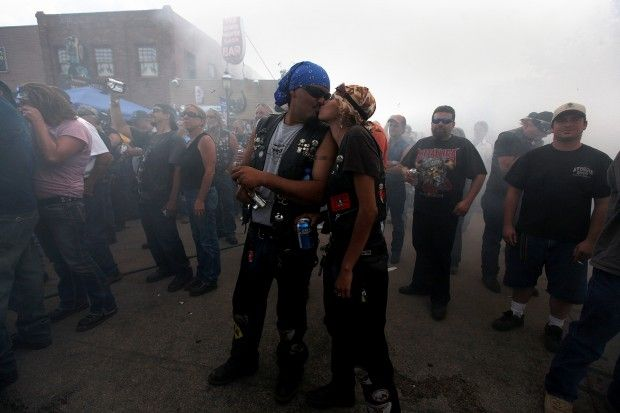 Ryan Groiego, left, and Twig Groiego, both from Colorado, kiss during The Dime Horseshoe Bar's annual burnout competition in Sundance on Wednesday, August 10, 2011. (Kristina Barker/Journal staff) #sturgis #SouthDakota #love