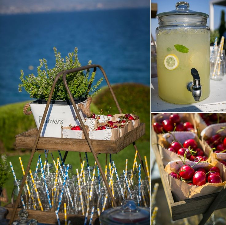 Refreshment table with fresh homemade lemonade and juicy red cherries to help your guests cope with the summer heat!