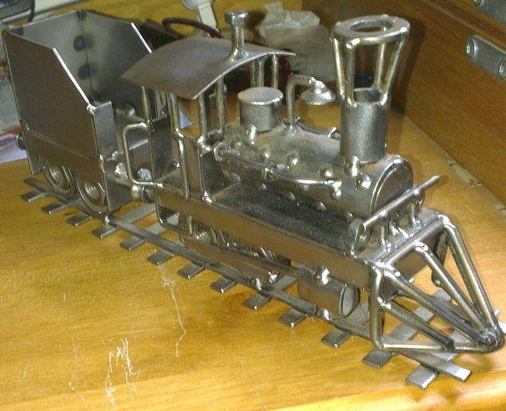 Hinz & Kunst Train locomotive steel sculpture by WildAtlanticCraft