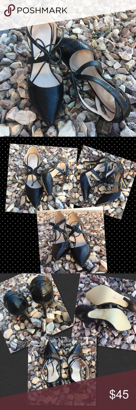 On Fleek They are gorgeous! Stiletto pumps! Gorgeous leather black snake style pumps to Rock your wardrobe. Wash away your troubles and sorrow with new shoes! Sensual strap tie with gold aglet ties nicely at the top for a perfect fit. A shoe that states classy! Shoes Heels
