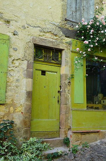 This is the color I painted my front door this year, it is really cheerful! .... Green Door in Cordes-sur-Ciel, FRANCE