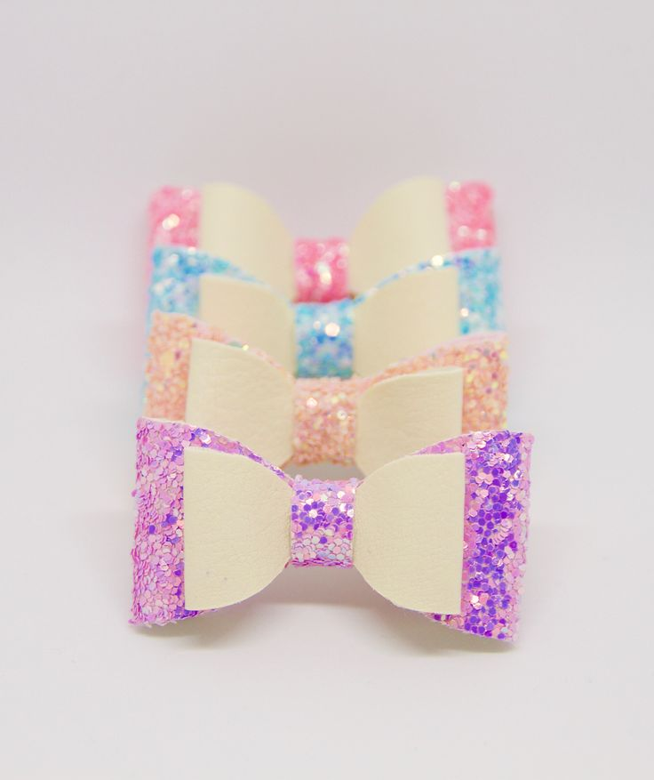 """Glitter Medium Sized Hair Bows.  A sparkly bow that any little princess would love! They are sold as a set but can also be purchased as single.   All my bows are designed and hand crafted by me personally and are made of great quality materials.   The bow is fitted with an alligator clip that measures 1.77"""", perfect for any type of hair.   Let me know if you want a specific design as I have multiple colors of fabric and I will be more than happy to make something special just for you."""