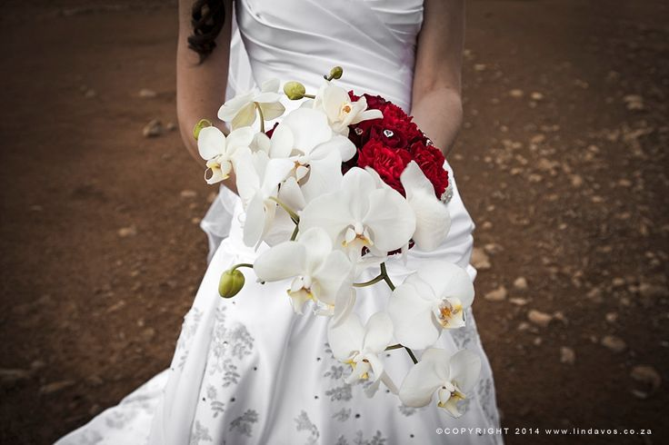 Bouquet of white orchids and red roses. www.lindavos.co.za