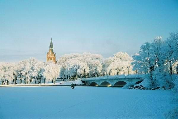 Ełk - widok na miasto zimą ze strony półwyspu zamkowego  Autor Krzysztof Korytko