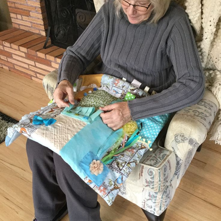 I love watching our Tantie playing with our quilts.