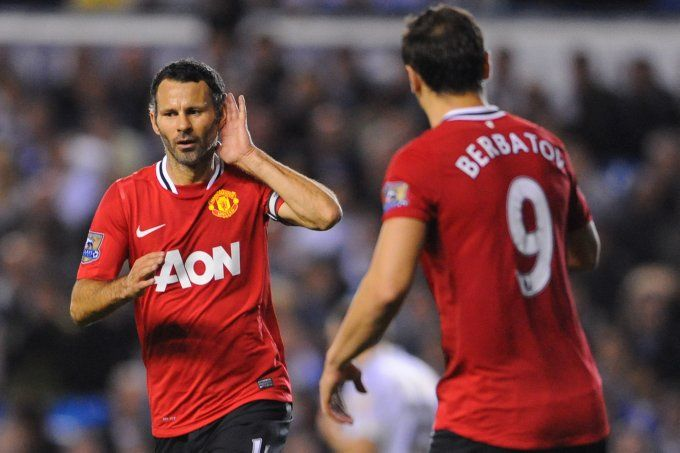 Ryan Giggs gestures to the Leeds fans after scoring Manchester United's third and final goal in their comfortable 3-0 win. The first two goals came courtesy of a Michael Owen brace on his first appearance of the campaign