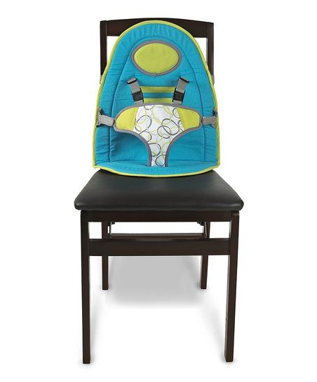 this soft pad is easily affixed to chairs using durable straps effectively any in restaurants or the a high chair
