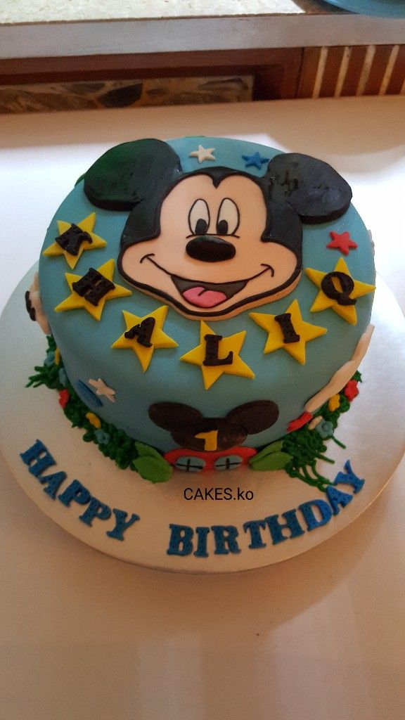 Mickey mouse club house Birthday cake for a little prince celebrating his 1st birthday..Click link to my business page for more of my work.