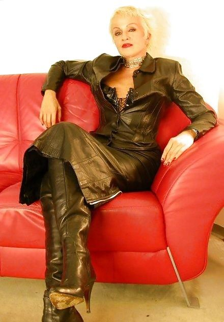 Mistress in leathers amp nylons playing with her bound slave 3