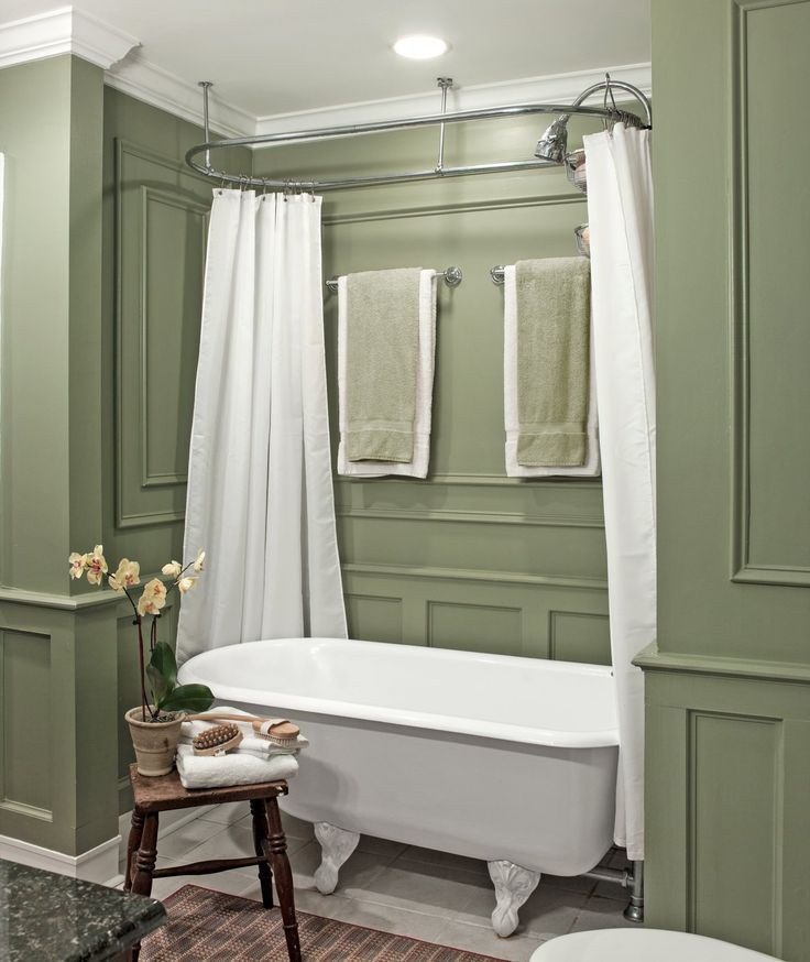 An expanded bathroom with an added claw-foot tub and molding on the walls recreates a Victorian feel.