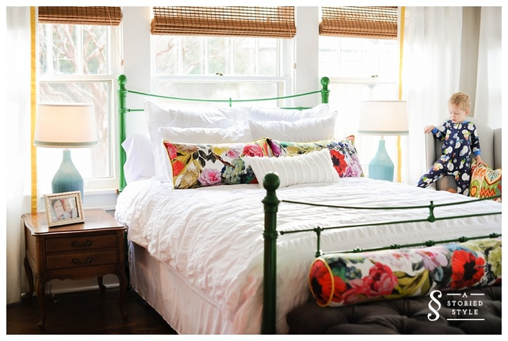 Orangerie Rose pattern brings so much color to this otherwise all white bed.