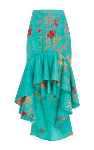 This **Johanna Ortiz** skirt features a high rise waist and a fluted shape.