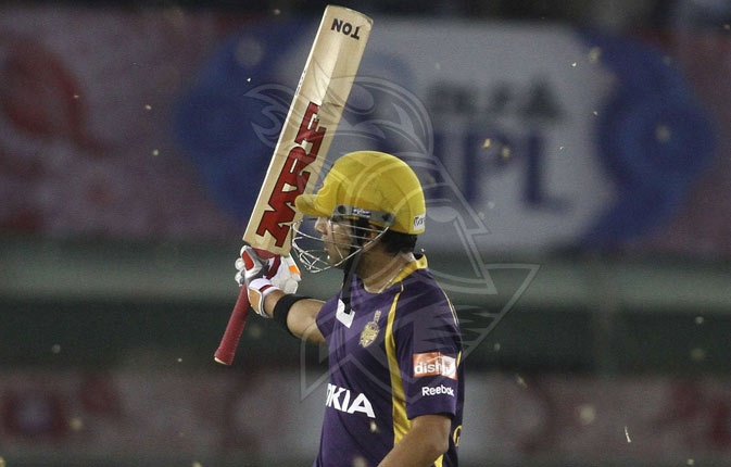 Gautam Gambhir acknowledges the crowd after reaching his 50 against KXIP