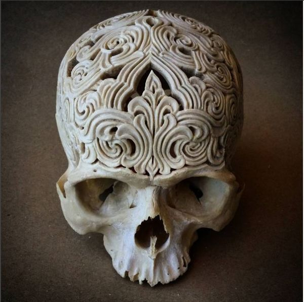 How did artist Rachel Lee acquire a human skull in good condition for this project? She doesn't explain and I'm not inclined to press her on the subject.For $2,200, you can own this skull, into which Lee has carved beautiful patterns. It would make a lovely conversation piece for, say, the reception area of an office or an enticing bachelor pad. It's one of many carved skulls that she sells, most of which belong to cattle. You can view them on her Instagram feed.-via The Soul Is Bone...