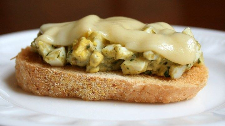 This egg salad sandwich is loosely based on an open-faced egg salad sandwich served at a local bistro. The unexpected pairing of pesto and Jarlsberg compliments the egg salad tremendously. The amounts of each ingredient can vary depending on taste.