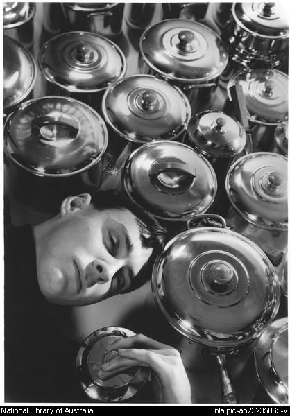 Dupain, Max, 1911-1992. Max Dupain, self portrait, with saucepans, Bond Street Studio, [Sydney], early 1930s