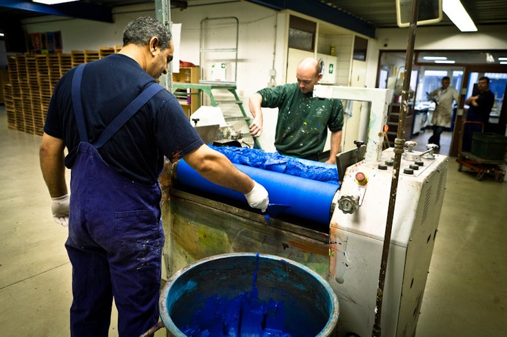 Old Holland production process step 3:     Depending on the sort of pigment used, the initial oil paint mixture is passed through a triple roll mill several times, to achieve optimum consistency