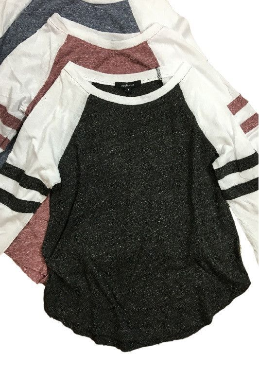 Look super cute at any game with this 3/4 sleeve baseball tee in a soft mixed cotton fabric. Available in 4 colors! 50% Cotton / 38% Polyester / 12% Rayon http://bellanblue.com