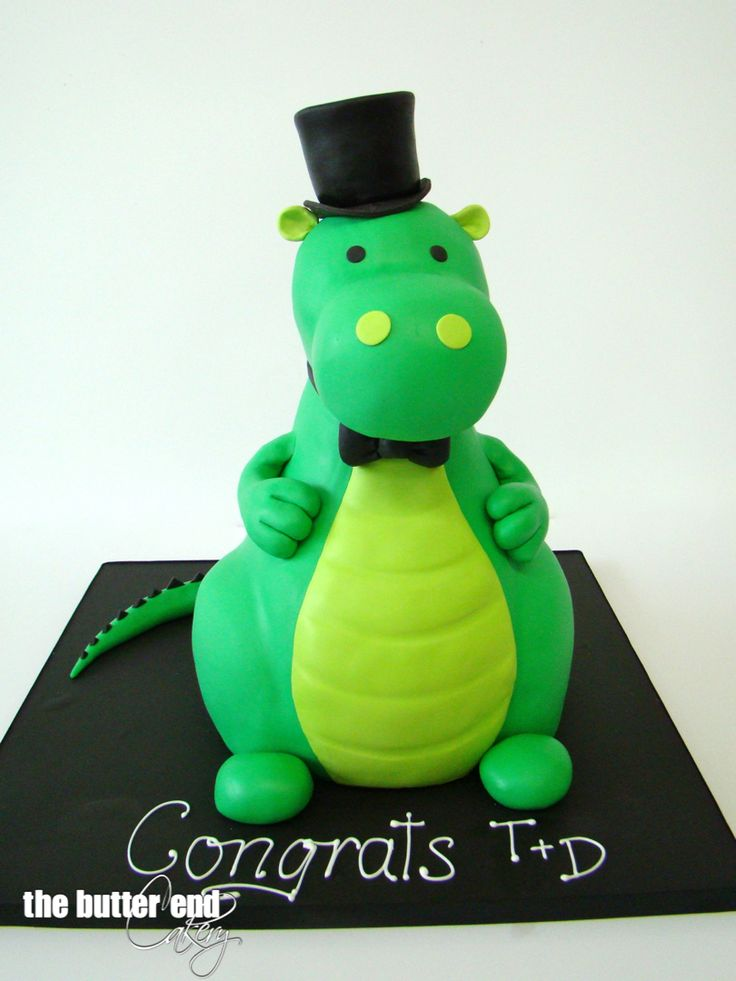 3-D sculpted baby dragon wedding cake with black bow tie and top hat by The Butter End Cakery