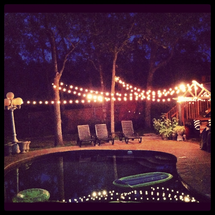 Backyard Party Lights Around The Pool For Engagement Party