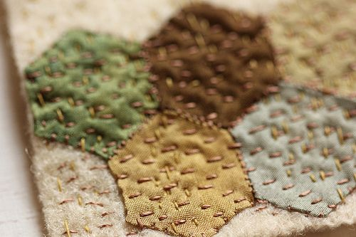 Mini hexies covered with running stitches - love.