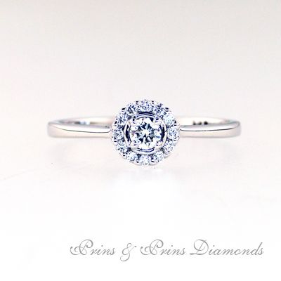 18k white gold ring with 0.13ct IJ SI round brilliant cut diamond micro set in 4 claw with a diamond halo around 13 = 0.12 cts    1R07044