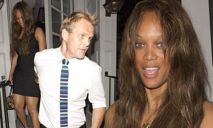 Tyra Banks looks dishevelled as boyfriend Erik Asla