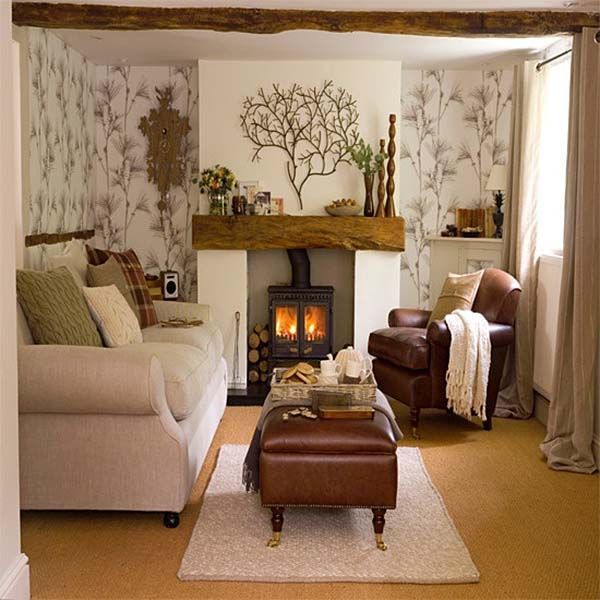 Cozy Living Room Design but the metal tree over the mantel is enough to much with the branch wallpaper too busy to be condusive  to relaxation
