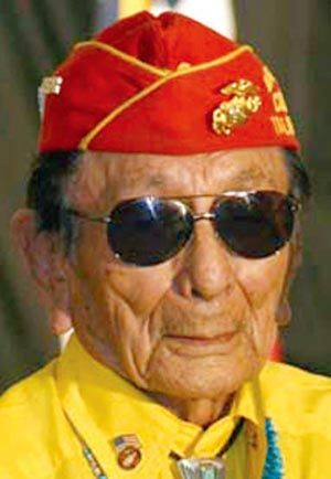 "Samuel Tom Holiday (1924 - ) was a Navajo Code Talker, US Marines Corps, 4th Marine Division, 25th Regiment, H & S Company during WWII. ""One of the hardest times I had was learning to talk the English,"" Holiday said. ""Whenever they (boarding school's instructors) found out I had talked Navajo, they made me scrub floor, scrub wall. I spent much of the first year scrubbing the wall."""