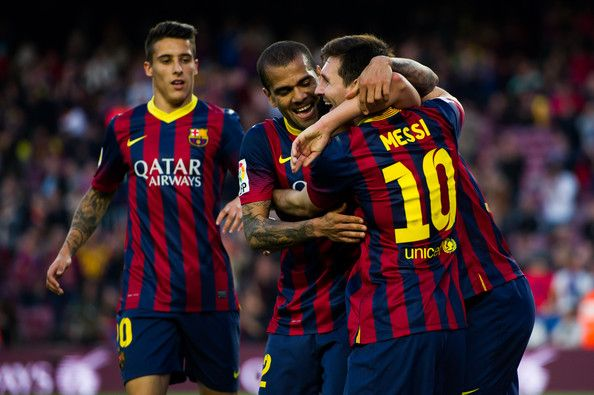 (L-R) Cristian Tello, Daniel Alves and Lionel Messi of FC Barcelona celebrate after his teammate Pedro Rodriguez (not seen) scored his team's seventh goal during the La Liga match between FC Barcelona and CA Osasuna at Camp Nou on March 16, 2014 in Barcelona, Catalonia.