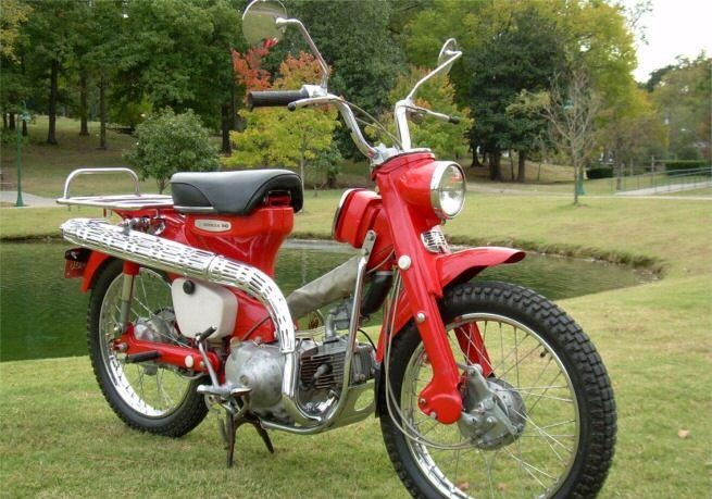 Mad Men (SE05, EP05: The Chrysanthemum & the Sword):  This is the same 'Scarlet Red' Honda Moped CT 90 Trail, this model is built around 1964 & called 'Super Cub', Peggy Olson (Elisabeth Moss) drives in the fake tv spot, whizz Don Draper (Jon Hamm) staged in the blank & white film studio to fool the adverse agency. Click for an ORIGINAL scene pic & more details about this cult city motor bike.