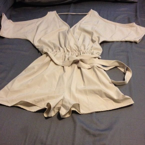 Sheer Romper Very sheer, beige one piece shorts outfit. Short sleeves with opening at the shoulders. Has a belt. Extremely low cut in front and back. Very sexy. Never been worn. Dresses