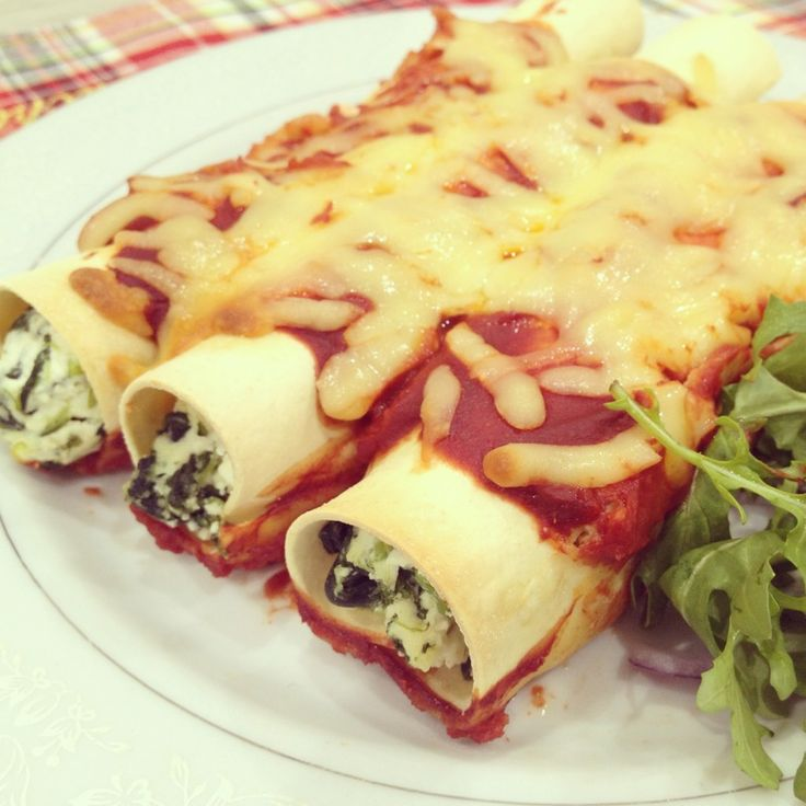 Cannelloni, which in Italian means 'large reeds' are cylinder shaped pasta served with a filling and sauce. For the filling you can use spinach, cheese or any variety of meat while the sauces are typically tomato or béchamel. They are very easy to make and a great dinner idea.