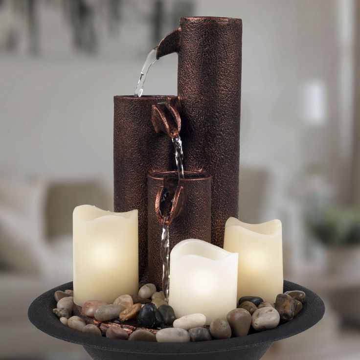 Bring the soothing sound of flowing water indoors with the Pure Garden Tiered Column Tabletop Fountain with Three Candles. Perfect for a table or desk, water cascades down three columns made of polyre