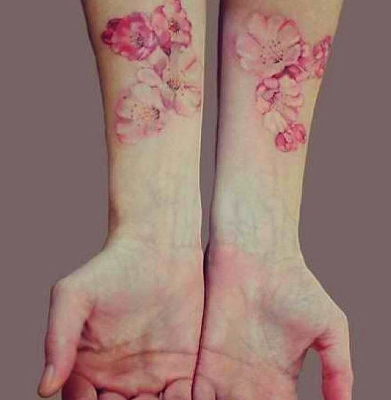Beautiful delicate watercolour type tattoo.Very pretty.                                                                                                                                                                                 More
