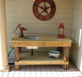 galvantized sink cute idea for potting table.. Tree legs...