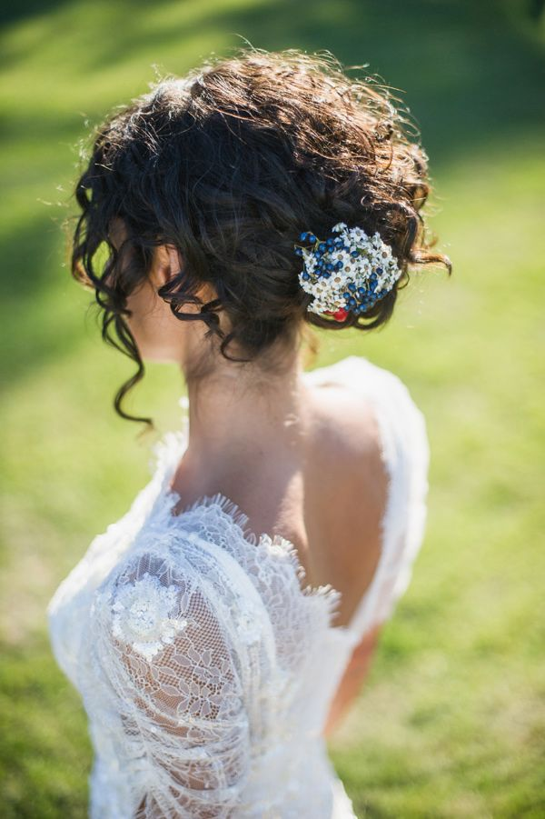 delicate lace and a curly updo, photo by Giuli&Giordi http://ruffledblog.com/san-sebastiano-da-po-destination-wedding #weddinghair #bridal #brides